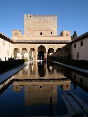 The palace of Alhambra in Granada. This image shows a beautiful pool inside the walls.