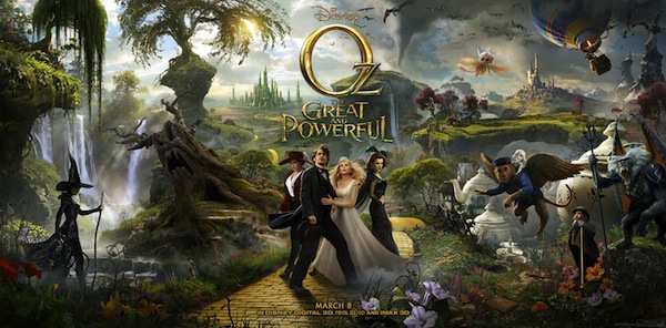 A movie poster for Oz: The Great and Powerful. So much going on here. Wizard is surrounded by three witches, emerald city in the background, flying monkey on the right, evil witch on the left.