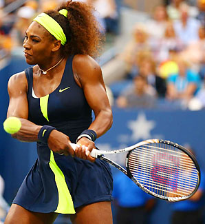 Serena hitting a tennis ball. She is wearing a blue and yellow one- piece skirt. Her hair is up with a yellow headband.