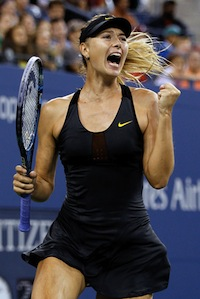 Maria Sharapova, in an all black one-piece outfit and black visor, with a tennis racket in hand, celebrates her victor and pumps her fist.