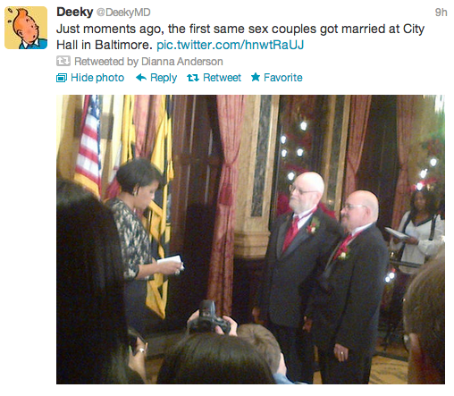 "DeekyMD tweeted picture of two men in tuxes standing before the mayor of Baltimore. The tweet reads: ""Just moments ago, the first same sex couples got married at City Hall in Baltimore."""