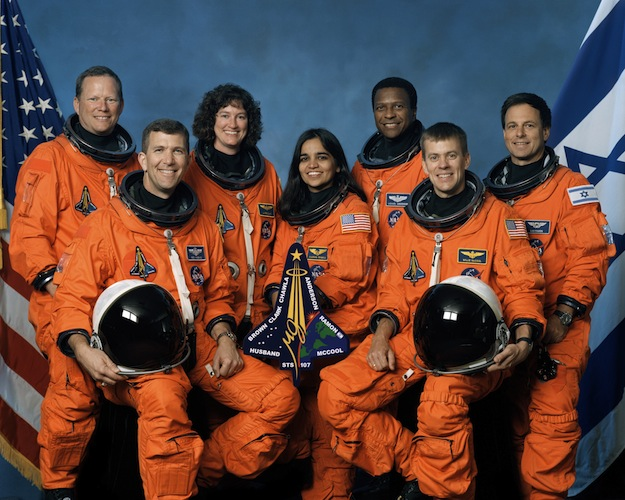 The STS-107 crew includes, from the left, Mission Specialist David Brown, Commander Rick Husband, Mission Specialists Laurel Clark, Kalpana Chawla and Michael Anderson, Pilot William McCool and Payload Specialist Ilan Ramon. (NASA photo)