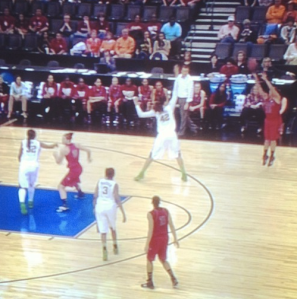 Shoni is mid shot, about four feet from behind the 3-point line. Brittney Griner is at the line and jumping up to block.