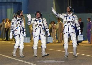 The International Space Station crew members (L to R) U.S. astronaut Karen Nyberg, Russian cosmonaut Fyodor Yurchikhin and Italian astronaut Luca Parmitano walk after donning space suits before the launch at the Baikonur cosmodrome May 28, 2013. REUTERS/Shamil Zhumatov